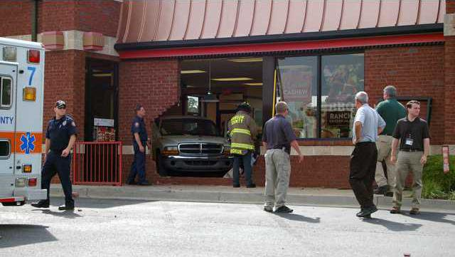 Truck drives into local restaurant pic