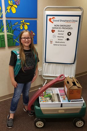 A-Girl Scout donates to GSC pic 1.jpg