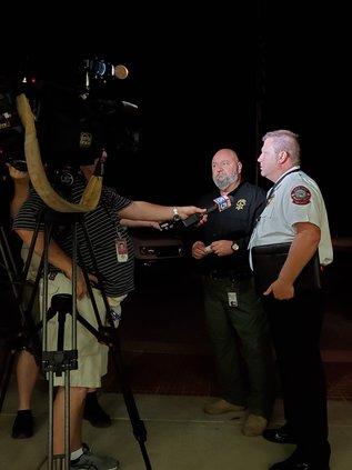 Sheriff Jeff Johnson and Fire Chief Danny Thompson brief the press