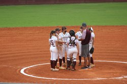 Coach Jimmy Pruett with Lady Tigers